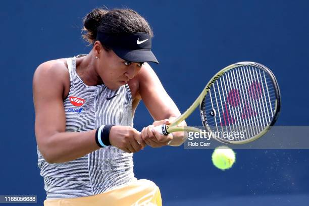 Naomi Osaka of Japan returns a shot to Aliaksandra Sasnovich of Belarus during Day 5 of the Western and Southern Open at Lindner Family Tennis Center...