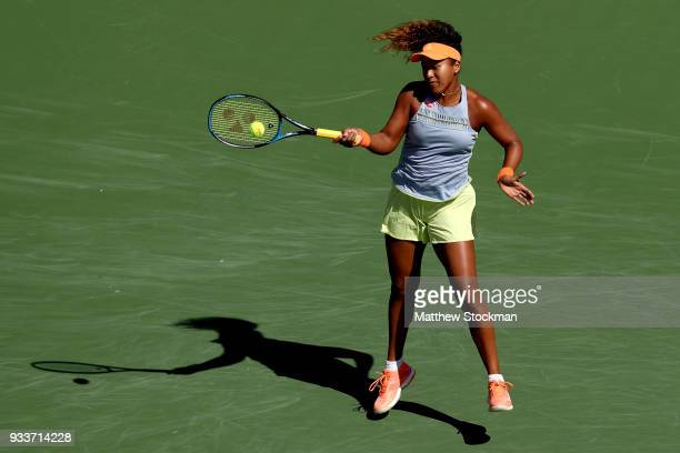Naomi Osaka of Japan returns a shot to Daria Kasatkina of Russia during the women's final on Day 14 of the BNP Paribas Open at the Indian Wells...