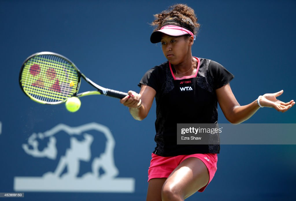 Naomi Osaka of Japan returns a shot to Samantha Stosur of Australia during Day 1 of the Bank of the West Classic at the Taube Family Tennis Stadium on July 28, 2014 in Stanford, California.