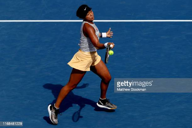 Naomi Osaka of Japan returns a shot to Sofia Kenin during the Western Southern Open at Lindner Family Tennis Center on August 16 2019 in Mason Ohio