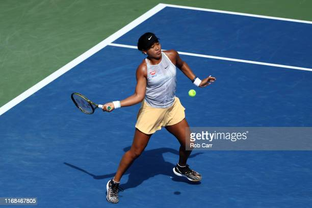 Naomi Osaka of Japan returns a shot to Sofia Kenin of the United States during Day 7 of the Western and Southern Open at Lindner Family Tennis Center...