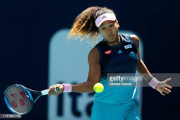 Naomi Osaka of Japan returns a shot to Yanina Wickmayer of Belgium during Day 5 of the Miami Open Presented by Itau at Hard Rock Stadium on March 22...