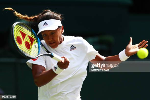 Naomi Osaka of Japan returns against Angelique Kerber of Germany during their Ladies' Singles third round match on day six of the Wimbledon Lawn...