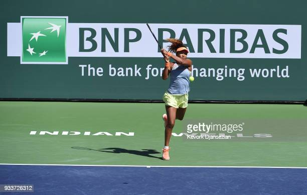 Naomi Osaka of Japan returns against Daria Kasatkina of Russia during the women's final on Day 14 of BNP Paribas Open on March 18 2018 in Indian...