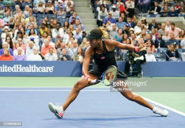 Naomi Osaka of Japan returns ball during women's single final of US Open 2018 against Serena Williams of USA at USTA Billie Jean King National Tennis...