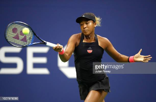 Naomi Osaka of Japan returns the ball during her women's singles semifinal match against Madison Keys of the United States on Day Eleven of the 2018...
