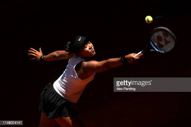 Naomi Osaka of Japan returns the ball in her match against Belinda Bencic of Switzerland during day six of the Mutua Madrid Open at La Caja Magica on...