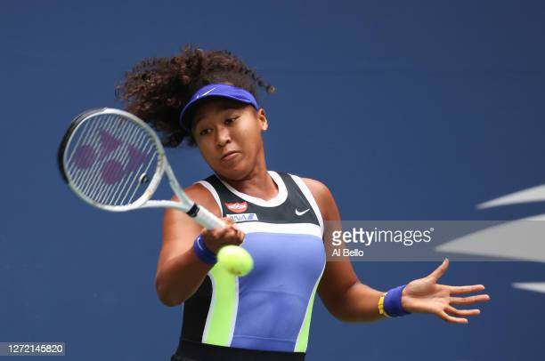 Naomi Osaka of Japan returns the ball in the first set during her Women's Singles final match against Victoria Azarenka of Belarus on Day Thirteen of...