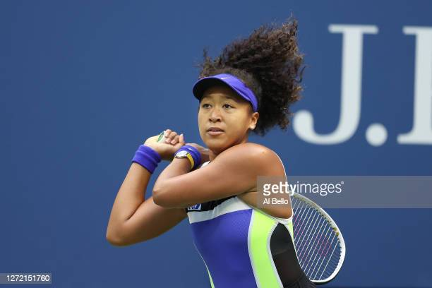 Naomi Osaka of Japan returns the ball in the second set during her Women's Singles final match against Victoria Azarenka of Belarus on Day Thirteen...