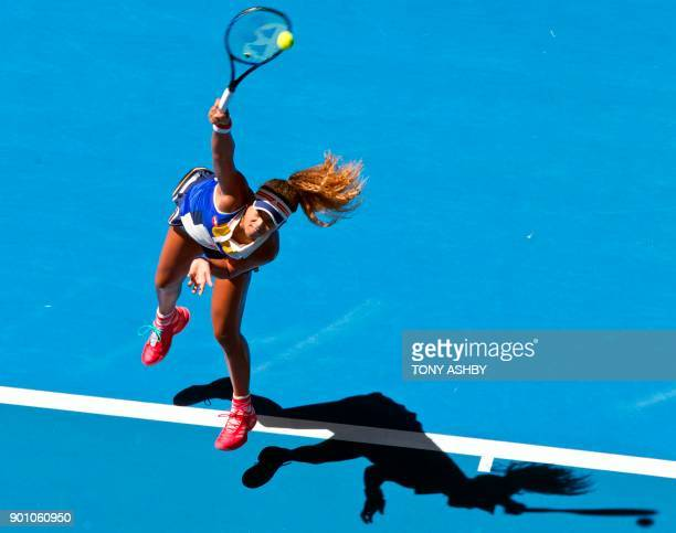TOPSHOT Naomi Osaka of Japan serves against Anastasia Pavlyuchenkova of Russia during their ninth session women's singles match on day six of the...