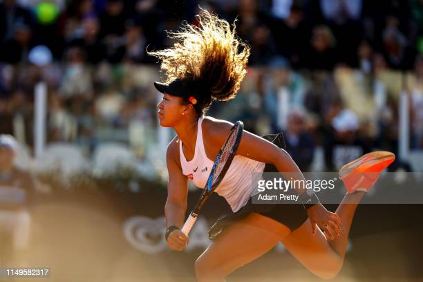 Naomi Osaka of Japan serves against Mihaela Buzarnescu of Romania in their Women's Singles Round of 16 match during Day Five of the International BNL...