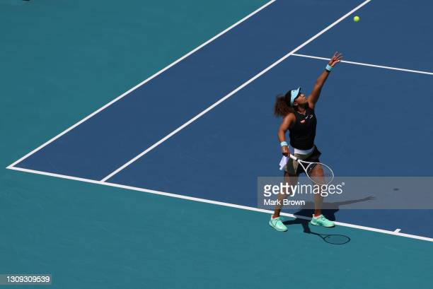 Naomi Osaka of Japan serves during her singles second round match against Ajla Tomljanović of Australia on Day 5 of the 2021 Miami Open presented by...
