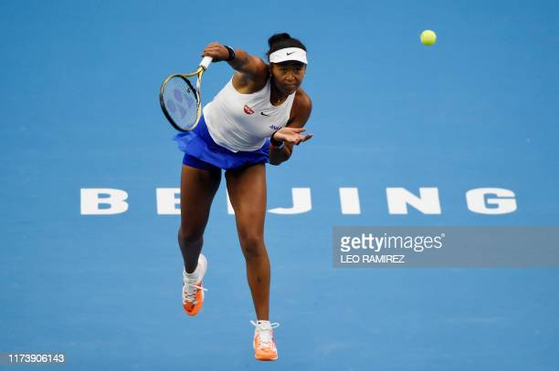 TOPSHOT Naomi Osaka of Japan serves during her women's singles final match against Ashleigh Barty of Australia at the China Open tennis tournament in...