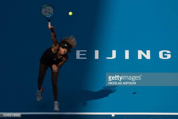 TOPSHOT Naomi Osaka of Japan serves during her women's singles third round match against Julia Goerges of Germany at the China Open tennis tournament...