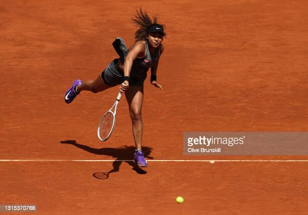 Naomi Osaka of Japan serves in her first round match against Misaki Doi of Japan during day two of the Mutua Madrid Open Tennis at La Caja Magica on...