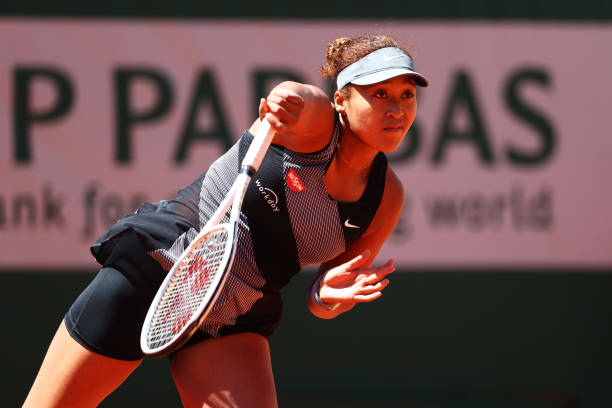 Naomi Osaka of Japan serves in her First Round match against Patricia Maria Tig of Romania during Day One of the 2021 French Open at Roland Garros on...