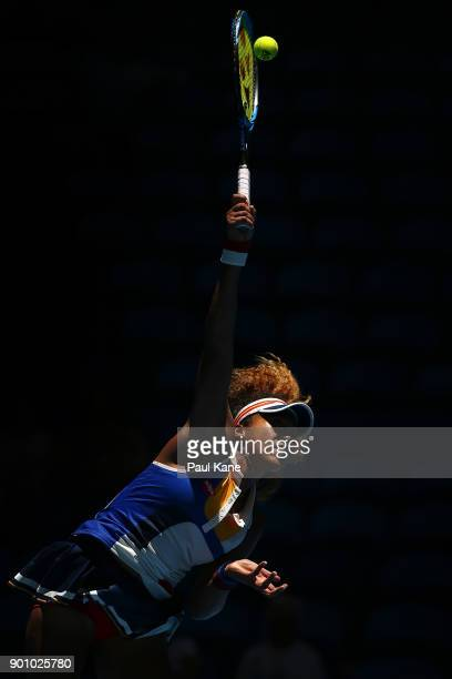 Naomi Osaka of Japan serves in her singles match against Anastasia Pavlyuchenkova of Russia on day six of the 2018 Hopman Cup at Perth Arena on...