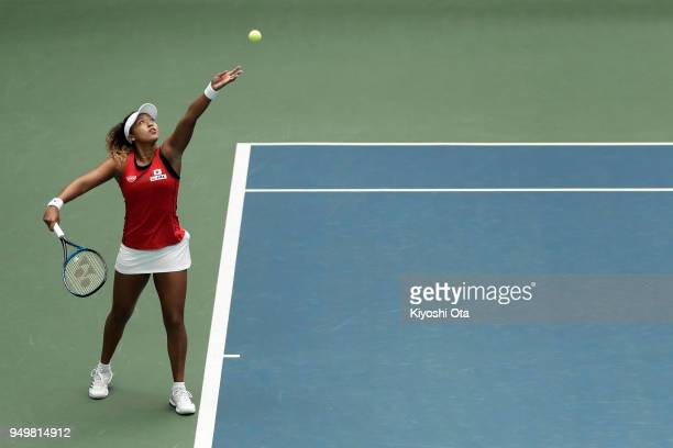 Naomi Osaka of Japan serves in her singles match against Johanna Konta of Great Britain during day two of the Fed Cup World Group II PlayOff between...