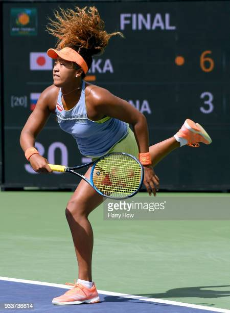 Naomi Osaka of Japan serves in her victory in the WTA final over Daria Kasatkina of Russia with her coach Sascha Bajin during the BNP Paribas Open at...