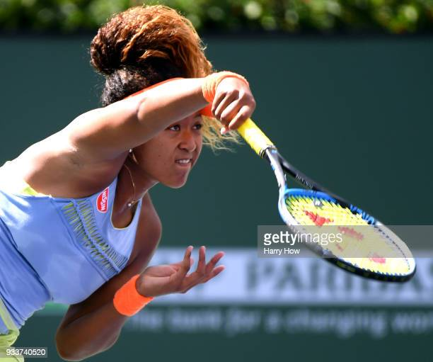 Naomi Osaka of Japan serves in her victory in the WTA final over Daria Kasatkina of Russia during the BNP Paribas Open at the Indian Wells Tennis...