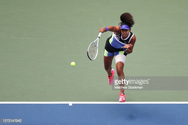 Naomi Osaka of Japan serves the ball in the first set during her Women's Singles final match against Victoria Azarenka of Belarus on Day Thirteen of...