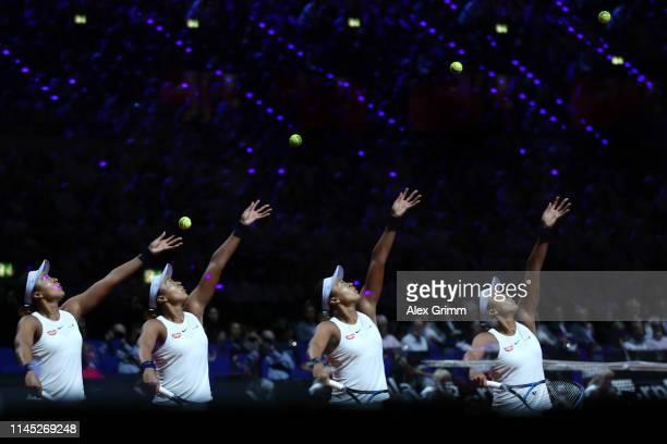 Naomi Osaka of Japan serves the ball to Donna Vekic of Croatia during their quarterfinal on day 5 of the Porsche Tennis Grand Prix at PorscheArena on...