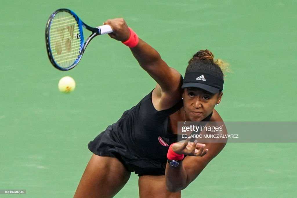TOPSHOT - Naomi Osaka of Japan serves the ball to Madison Keys of the US during their 2018 US Open women's singles semi-finals tennis match on September 6, 2018 in New York.