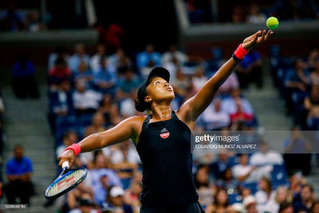 Naomi Osaka of Japan serves the ball to Madison Keys of the US during their 2018 US Open women's singles semi-finals tennis match on September 6, 2018 in New York.