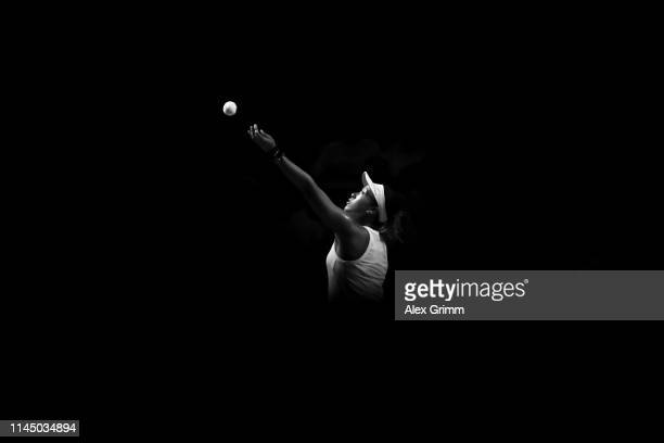 Naomi Osaka of Japan serves the ball to SuWei Hsieh of Taiwan during their round of 16 match on day 4 of the Porsche Tennis Grand Prix at...