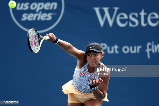 Naomi Osaka of Japan serves to Aliaksandra Sasnovich of Belarus during Day 5 of the Western and Southern Open at Lindner Family Tennis Center on...