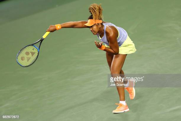Naomi Osaka of Japan serves to Simona Halep of Romania during their semifinal match at the BNP Paribas Open Day 12 on March 16 2018 in Indian Wells...