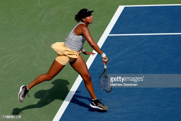 Naomi Osaka of Japan serves to Sofia Kenin during the Western Southern Open at Lindner Family Tennis Center on August 16 2019 in Mason Ohio