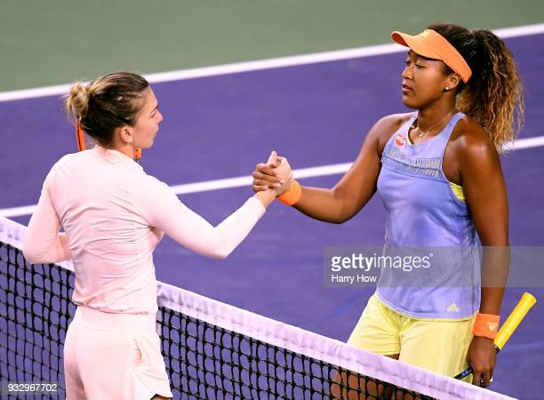 Naomi Osaka of Japan shakes hands after her semifinal victory over Simona Halep of Romania during the BNP Paribas Open at the Indian Wells Tennis...