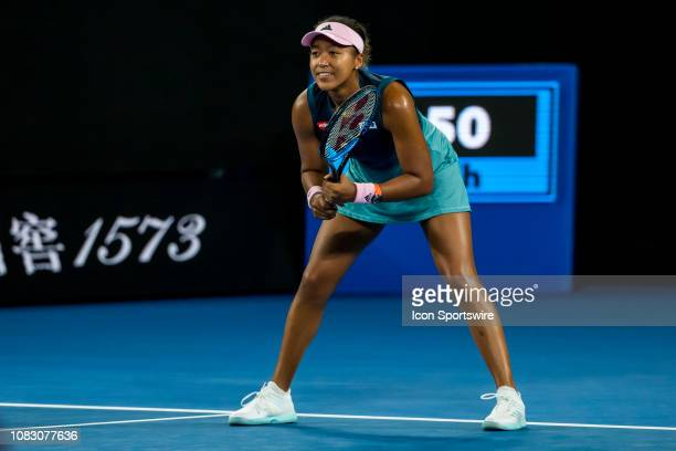 Naomi Osaka of Japan smiles while preparing to receive the ball during day 2 of the Australian Open on January 15 2019 at Melbourne Park in...