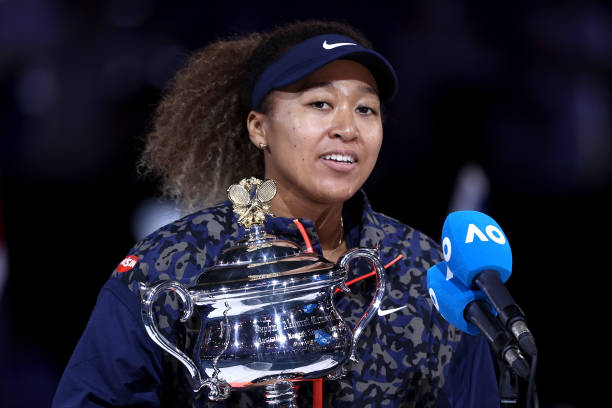 Naomi Osaka of Japan speaks on stage as she holds the Daphne Akhurst Memorial Cup after winning her Women's Singles Final match against Jennifer...
