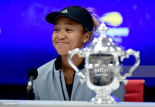 Naomi Osaka of Japan speaks to the media after winning the Women's Singles finals match against Serena Williams of the United States on Day Thirteen...