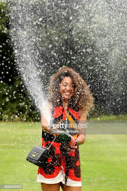 Naomi Osaka of Japan sprays champagne after winning the 2021 Australian Open Women's Final, at Government House on February 21, 2021 in Melbourne,...