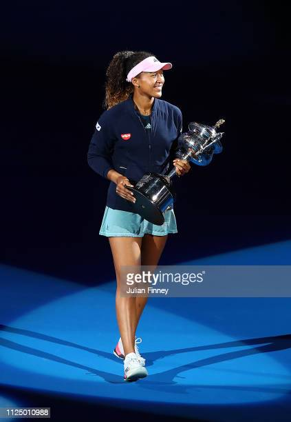 Naomi Osaka of Japan takes part in a lap of honour with the Daphne Akhurst Memorial Cup following victory in her Women's Singles Final match against...