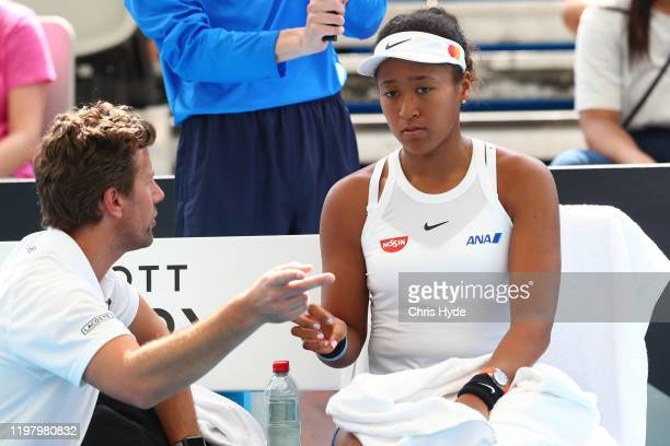 Naomi Osaka of Japan talks with her coach in her match against Maria Sakkari of Greece during day two of the 2020 Brisbane International at Pat...