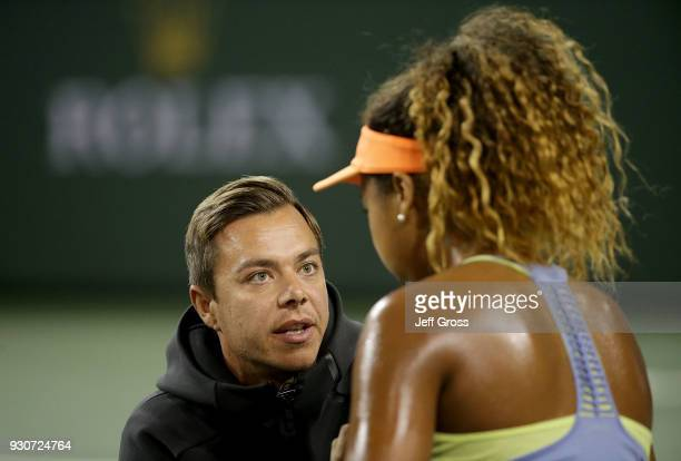 Naomi Osaka of Japan talks with her coach Sascha Bajin while playing Sachia Vickery during the BNP Paribas Open on March 11 2018 at the Indian Wells...
