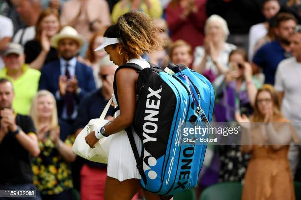 Naomi Osaka of Japan walks off the court after loosing her Ladies' Singles first round match against Yulia Putintseva of Kazakhstan during Day one of...