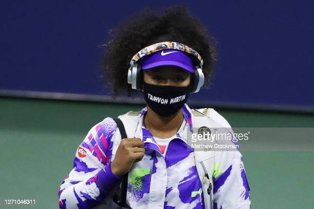 Naomi Osaka of Japan walks out wearing a mask with the name of Trayvon Martin printed on it before her Women's Singles fourth round match against...