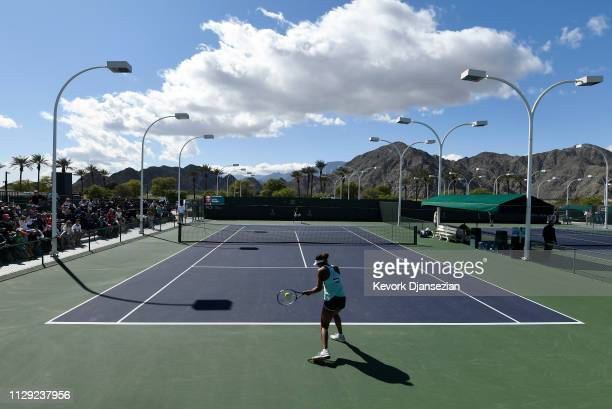 Naomi Osaka of Japan warms on the practice court during day five of BNP Paribas Open on March 8, 2019 in Indian Wells, California.