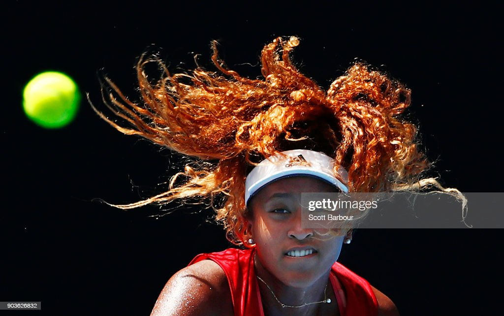 Naomi Osaka of Japan watches the ball as she serves during a practice session ahead of the 2018 Australian Open at Melbourne Park on January 11, 2018 in Melbourne, Australia.