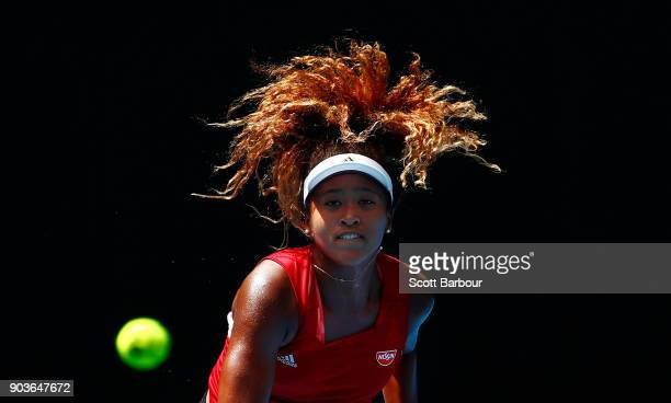 Naomi Osaka of Japan watches the ball as she serves during a practice session ahead of the 2018 Australian Open at Melbourne Park on January 11 2018...