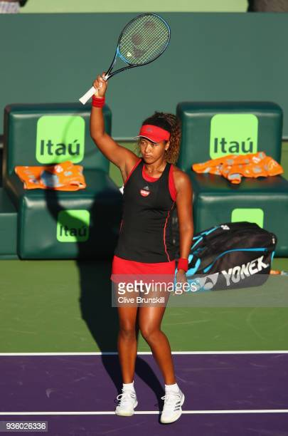 Naomi Osaka of Japan waves to the crowd after her straight sets victory against Serena Williams of the United States in their first round match...
