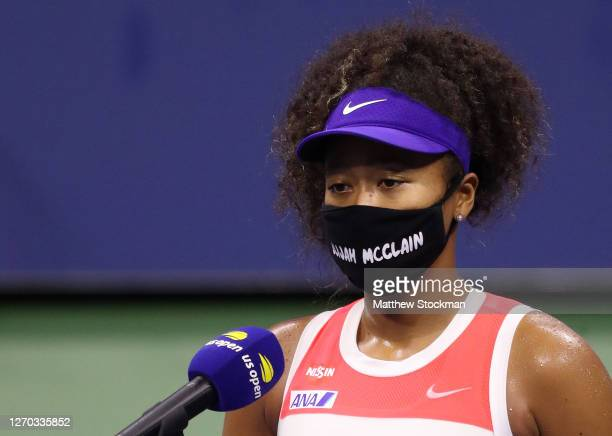 Naomi Osaka of Japan wears a mask with the name Elijah McClain on it following her Women's Singles second round win against Camila Giorgi of Italy on...