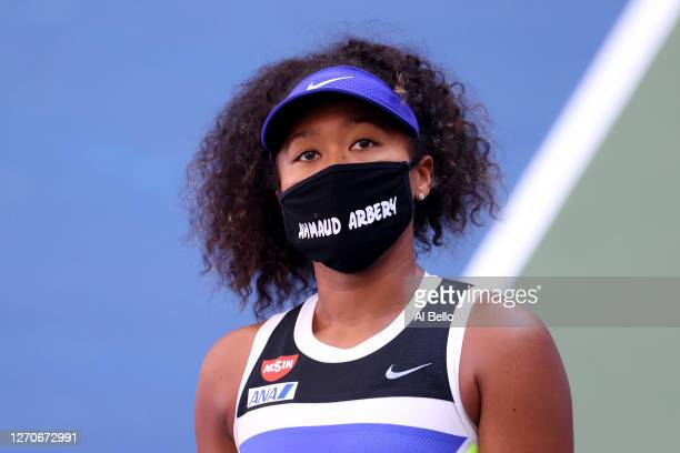 Naomi Osaka of Japan wears a protective face mask with the name, Ahmaud Arbery stenciled on it after winning her Women's Singles third round match...