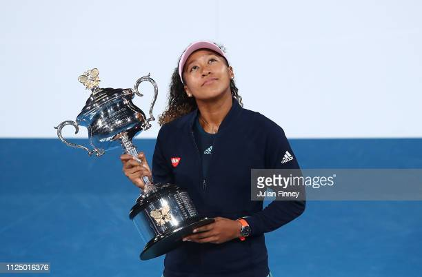 Naomi Osaka of Japan with the Daphne Akhurst Memorial Cup following victory in her Women's Singles Final match against Petra Kvitova of the Czech...