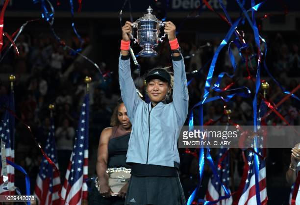 Naomi Osaka of Japan with trophy after winning against Serena Williams of the US during their Women's Singles Finals match at the 2018 US Open at the...